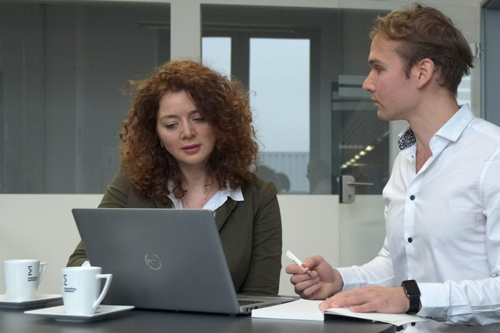 Mounting Systems employees in a meeting